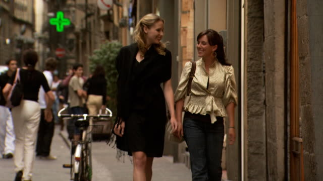 two women walking down the street talking - see other clips from this shoot 1150 stock videos and b-roll footage