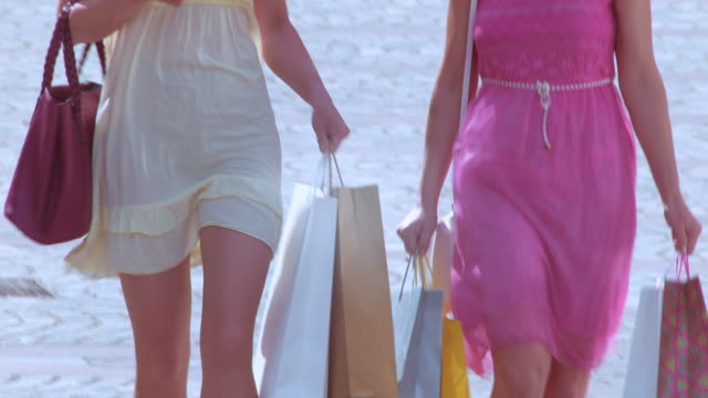 TD Two women walking down the street with shopping bags