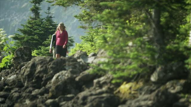 ms la two women walking through garibaldi provincial park, squamish, british columbia, canada - garibaldi park stock videos & royalty-free footage