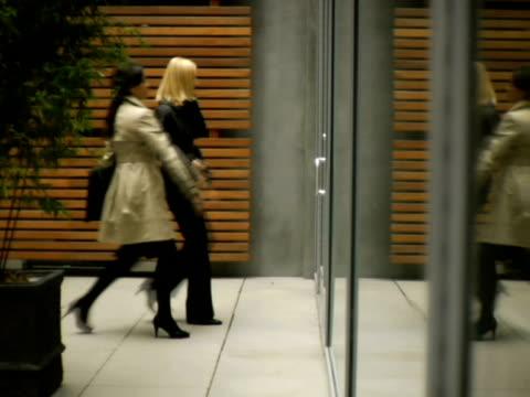 Ws Two Women Walking Through Glass Door New York City New York Usa