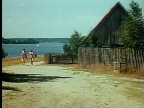 1994 zo ws two women walking up path towards chalet housing/ poland/ audio - stone wall stock videos & royalty-free footage