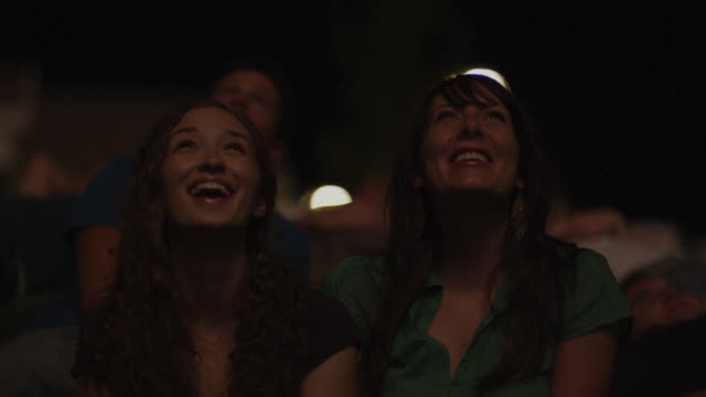 two women watching fireworks - firework display stock videos & royalty-free footage