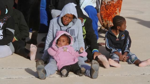 two women were found dead and 290 migrants rescued from two boats off the coast of libya on sunday according to the navy - libya stock videos & royalty-free footage