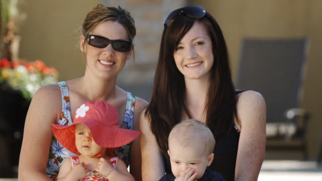 two women with babies by the pool - see other clips from this shoot 1421 stock videos & royalty-free footage
