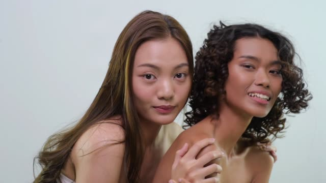 two women with glowing skin making facial expressions - two objects stock videos and b-roll footage