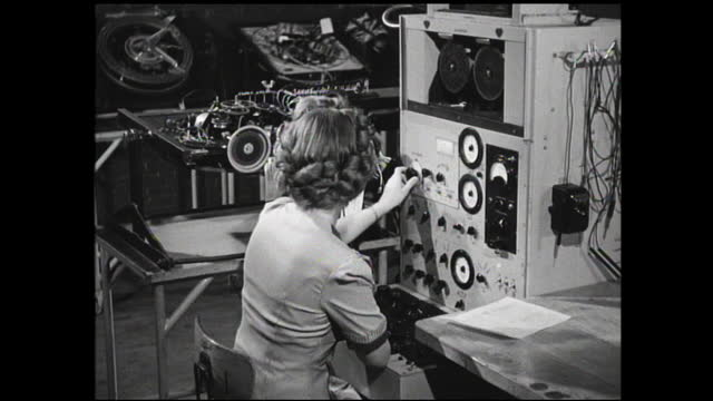 two women workers placing top on round assembly and woman adjusting dials and controls - 1940 1949 stock videos & royalty-free footage