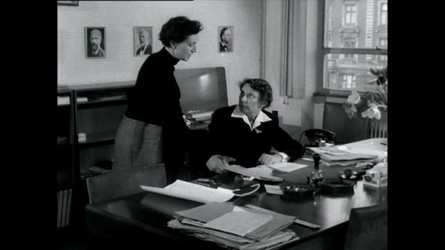 two women working in an office environment; 1955 - only mid adult women stock videos & royalty-free footage