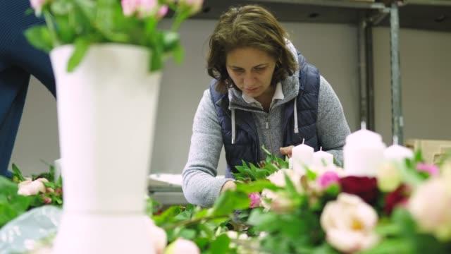 two women working in flower workshop - flower arrangement stock videos and b-roll footage