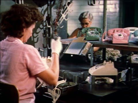 1959 two women working on telephones on assembly line - 1959 stock-videos und b-roll-filmmaterial