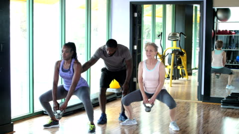 two women working out together with fitness instructor - 30 39 years stock videos & royalty-free footage