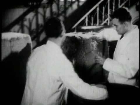 1936 b/w two workers brewing beer at anheuser busch brewery in st. louis / missouri, united states  - anheuser busch brewery missouri stock videos and b-roll footage