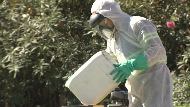 two workers during spraying work against mosquitoes causing the nile virus in coria del rio. - spraying stock videos & royalty-free footage