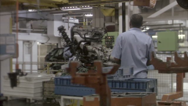 ms, pan, two workers in car factory, brazil - machine part stock videos & royalty-free footage