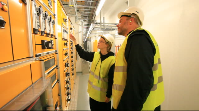 two workers in the control room of karahnjukar hydro electric power station that generates 40% of icelands electricity. - control stock videos & royalty-free footage