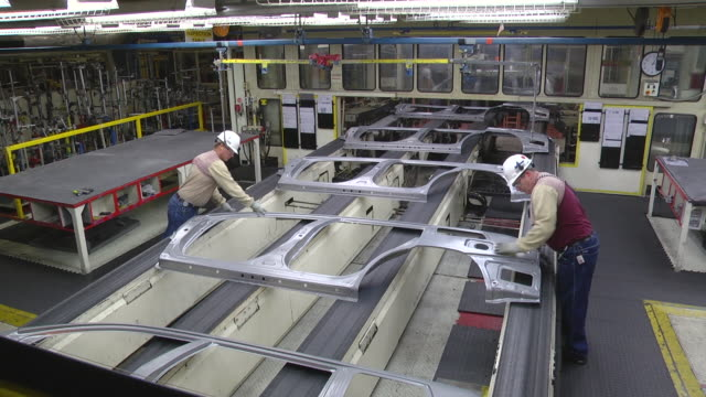 ms two workers inspect sheet metal stampings before they are welded together to form mini van / princeton, indiana, united states - manufacturing machinery stock videos & royalty-free footage