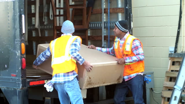 two workers loading big box onto delivery truck - land vehicle stock videos & royalty-free footage