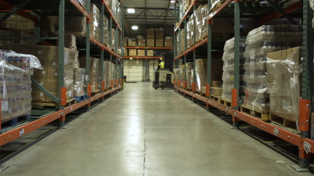 two workers using forklifts in a warehouse - packet stock videos and b-roll footage