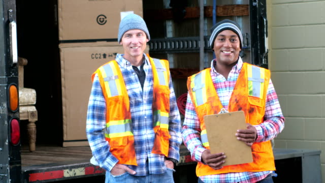 two workers with a truck delivering boxes - loading stock videos & royalty-free footage