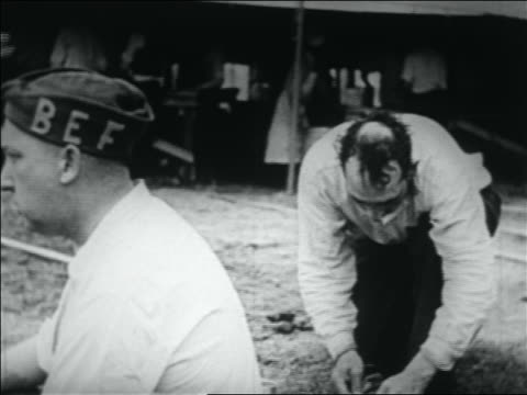 b/w 1932 two wwi veterans eating outdoors / bonus march in washington dc - 1932 stock videos & royalty-free footage