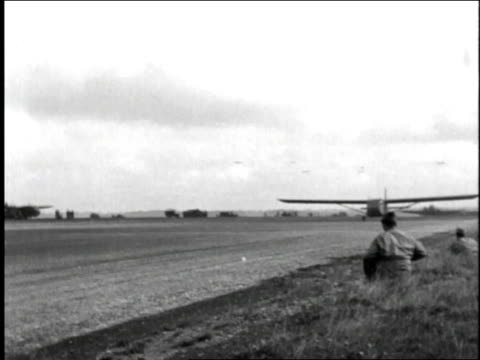 two wwii allied airplanes take off down runway and into the air / france - 1944 stock videos and b-roll footage
