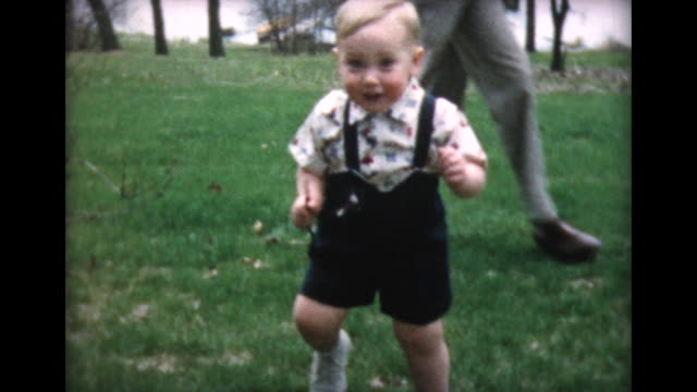 1957 two year old boy poses on lawn with dad - toddler stock videos & royalty-free footage