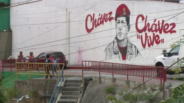 vídeos de stock, filmes e b-roll de two years after hugo chavez's death his chosen heir nicolas maduro struggles to maintain the popularity of chavismo - maduro