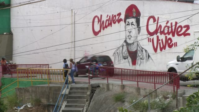 two years after hugo chavez's death his chosen heir nicolas maduro struggles to maintain the popularity of chavismo - heir stock videos and b-roll footage