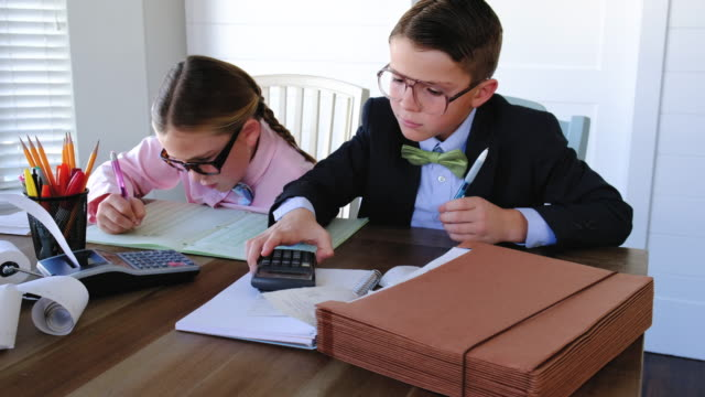 two young accountants at work - tax form stock videos & royalty-free footage