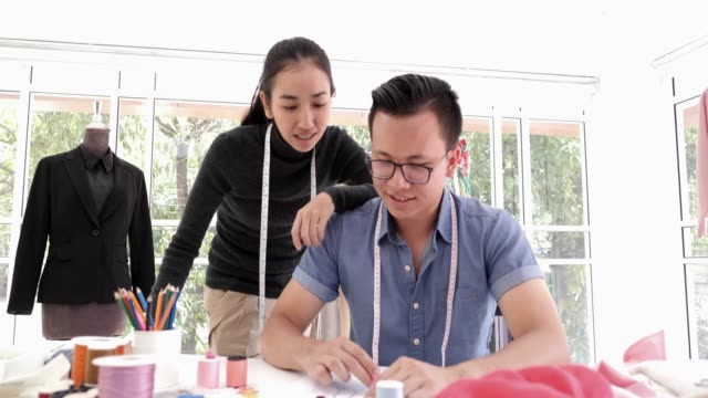 two young adult fashion designers, tailor and dressmaker adjusting clothes on tailoring mannequin - tahiti stock videos & royalty-free footage