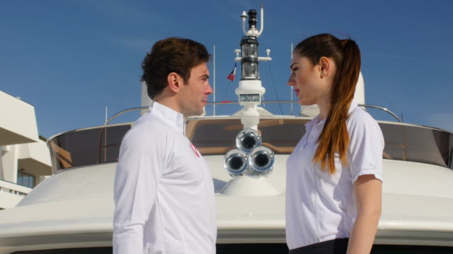 two young adult on yacht - polo shirt stock videos & royalty-free footage