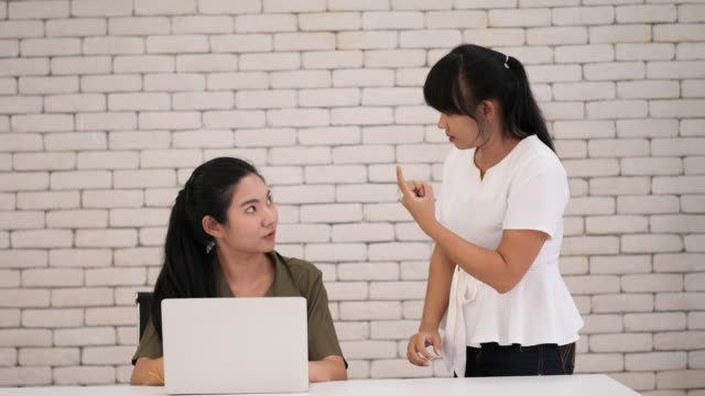 two young asian women discussing work in sign language - sign language stock videos & royalty-free footage