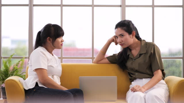two young asian women discussing work in sign language - persons with disabilities stock videos & royalty-free footage