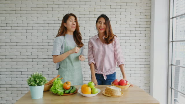 two young asian women food blogger showing thumbs up and subscribe while recording video for broadcast, vlog healthy lifestyle - subscribe stock videos and b-roll footage
