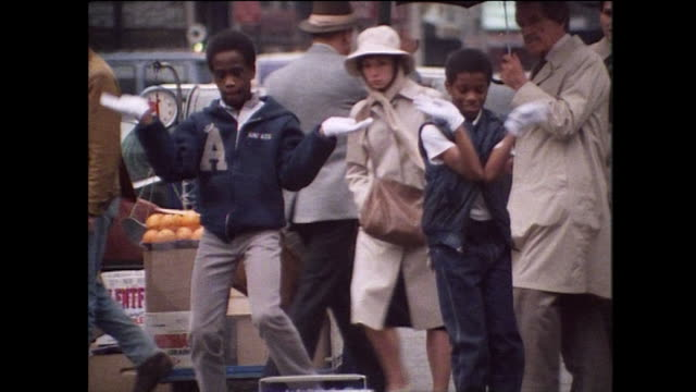 two young boys bodypop on the street in new york; 1984 - bbc archive stock-videos und b-roll-filmmaterial