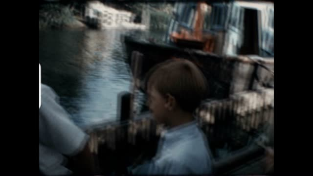 Two young boys in Frontierland at Disneyland in this archival home movie from the 1960's