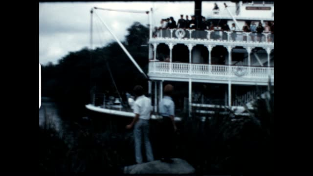 two young boys look over the mark twain riverboat at disneyland in this archival home movie from the 1960's. - mark twain stock videos & royalty-free footage