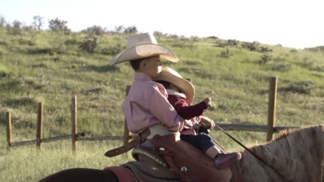 two young boys riding a horse in a field - ranch stock videos & royalty-free footage