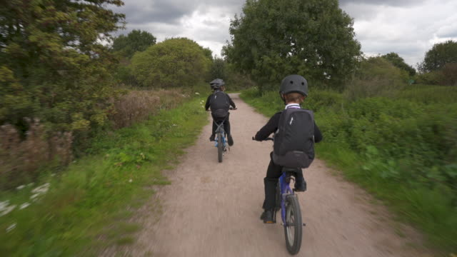 Two young brothers cycling together