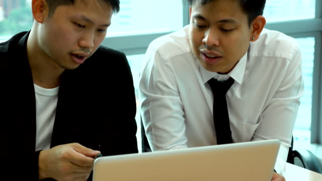 Two young Business teamwork talk and discussion