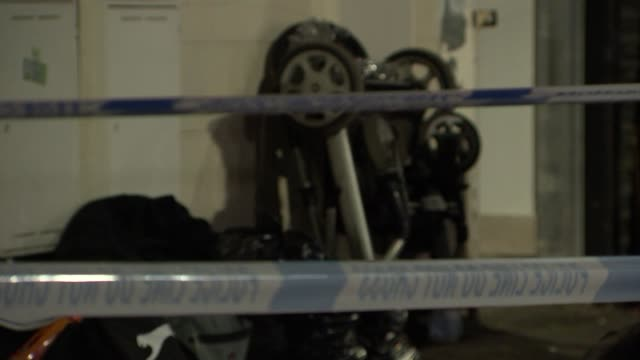 vídeos de stock, filmes e b-roll de two young children stabbed to death in east london: crime scene gvs; england: london: ilford: ext / night gvs cordoned-off grocery shop with flat... - ilford