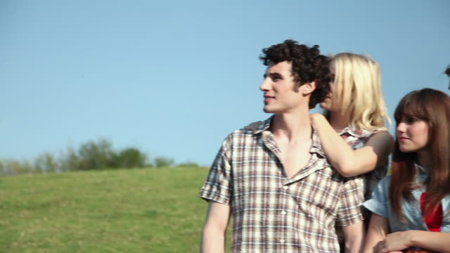two young couples in a field - guildford stock videos & royalty-free footage