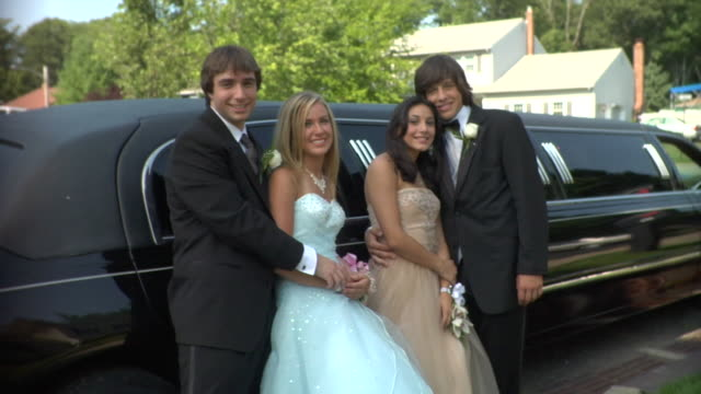 ms, two young couples in prom attire posing beside limo, portrait, edison, new jersey, usa - boutonniere stock videos and b-roll footage