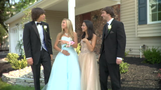 ms, two young couples in prom attire standing in front of house, edison, new jersey, usa - boutonniere stock videos and b-roll footage