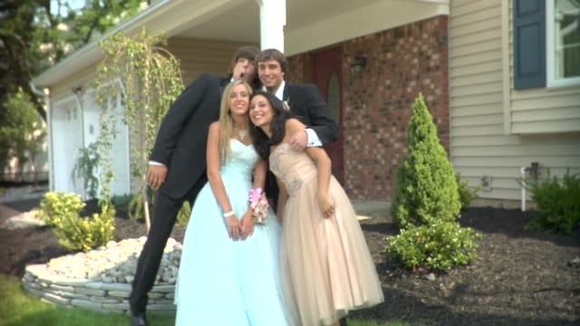 ms, two young couples in prom attire standing in front of house, portrait, edison, new jersey, usa - high school prom stock videos and b-roll footage