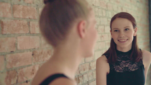 two young dancers talking - leotard stock videos and b-roll footage