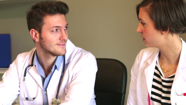 Two young doctors discussing medical case
