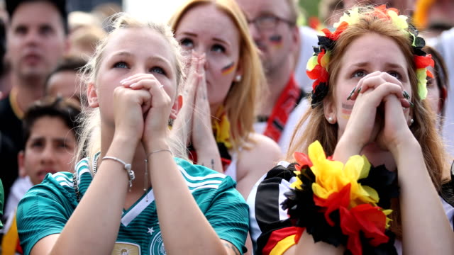 two young german female fans in football shirts are praying while germany is loosing the 2018 fifa world cup russia group f match against korea... - fußballweltmeisterschaft stock-videos und b-roll-filmmaterial