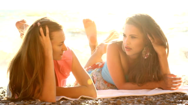 hd two young girl talking on sea beach - sunbathing stock videos and b-roll footage
