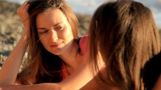 HD Two young girl talking on sea beach