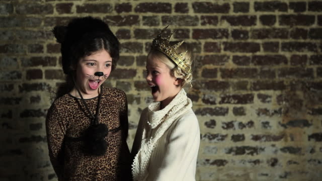 two young girls in dressing up clothes, hugging - crown headwear stock videos and b-roll footage